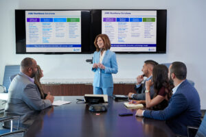 corporate business lifestyle photography of executive leading a meeting in the conference room